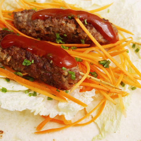 Lula kebab with salad from carrots in pita